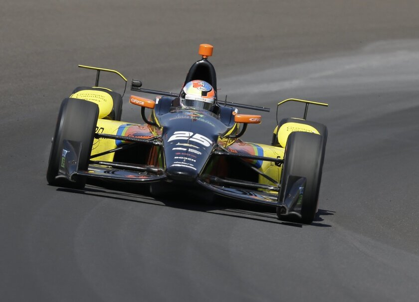 Stefan Wilson, of England, drives through turn one during the final practice session for the Indianapolis 500 auto race at Indianapolis Motor Speedway in Indianapolis, Friday, May 27, 2016. (AP Photo/Michael Conroy)