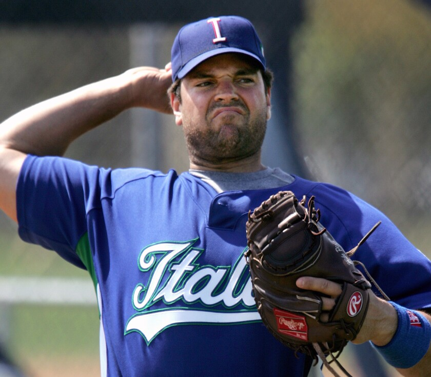 FILE - In this March 3, 2006, file photo, World Baseball Classic series Italian team catcher Mike Piazza winds up for a throw during a team workout in Lakeland, Fla. Hall of Fame catcher Mike Piazza says he has agreed to become manager of Italy's national baseball team. The 51-year-old Piazza, who was born in Norristown, Pennsylvania, is of Italian ancestry. He tweeted Wednesday, Nov. 13, 2019, he will manage Italy at a European tournament in 2020 and at the 2021 World Baseball Classic. (AP Photo/Steven Senne, File)