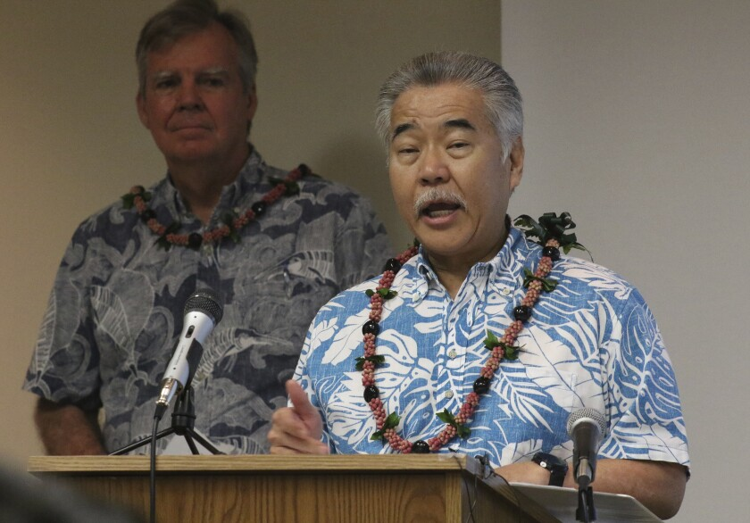 """FILE - In this Tuesday, March 3, 2020, file photo, Hawaii Gov. David Ige speaks to reporters at the state Department of Health's laboratory in Pearl City, Hawaii. Ige said Monday, July 13, 2020, he will wait another month to waive a 14-day quarantine requirement for out-of-state travelers who test negative for COVID-19, citing increasing virus cases in Hawaii, """"uncontrolled"""" outbreaks in several U.S. mainland states and a shortage of testing supplies. (AP Photo/Audrey McAvoy, File)"""