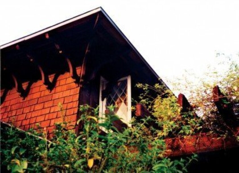 These diamond-paned windows (as seen in this photo taken a few years prior to Windemere's demolition) were part of the historic character of Irving Gill's early California Craftsman cottage. File