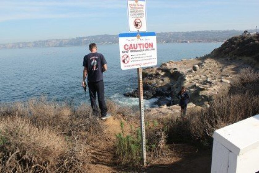 La Jolla fire safety personnel check out a trail leading to the bluffs above La Jolla Cove. The city increased access to the bluffs on Dec. 31, 2013 by installing a gate in the fence along Coast Boulevard.  Pat Sherman