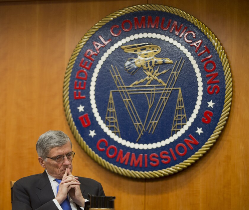 Federal Communications Commission Chairman Tom Wheeler listens to commissioners speak prior to a 2015 vote on net neutrality rules for online traffic.
