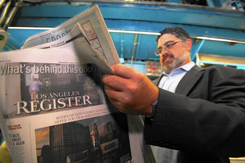 Freedom Communications reported that 29 newsroom employees lost their jobs amid the closure of the L.A. Register. Above, Freedom co-owner Eric Spitz peruses one of the first copies of the newspaper in April.