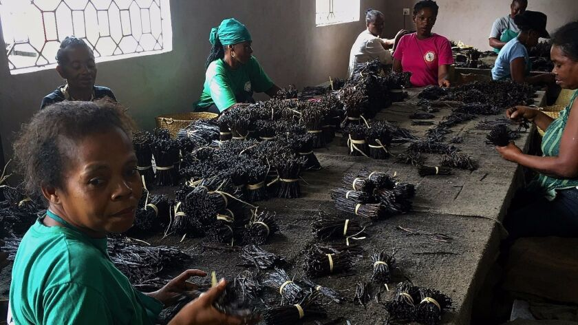 Workers sort, grade and bundle vanilla beans in a warehouse in the town of Antalaha in northeast Madagascar.