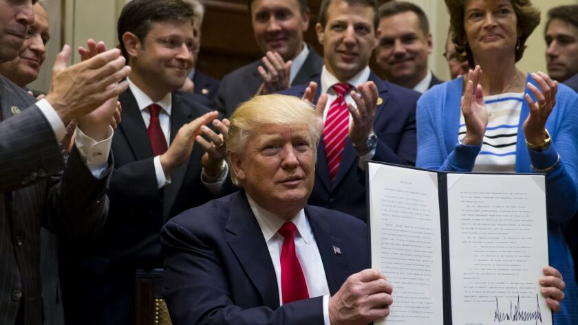 President Donald Trump signs an executive order on implementing an America-First Offshore Energy Str