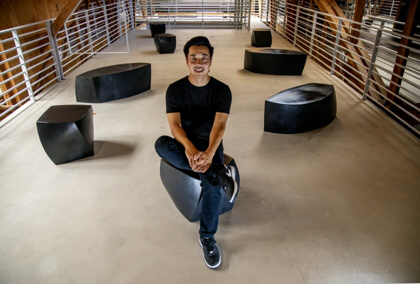 Eddy Lu, CEO of GOAT Group, pictured sitting on a cubic chair.