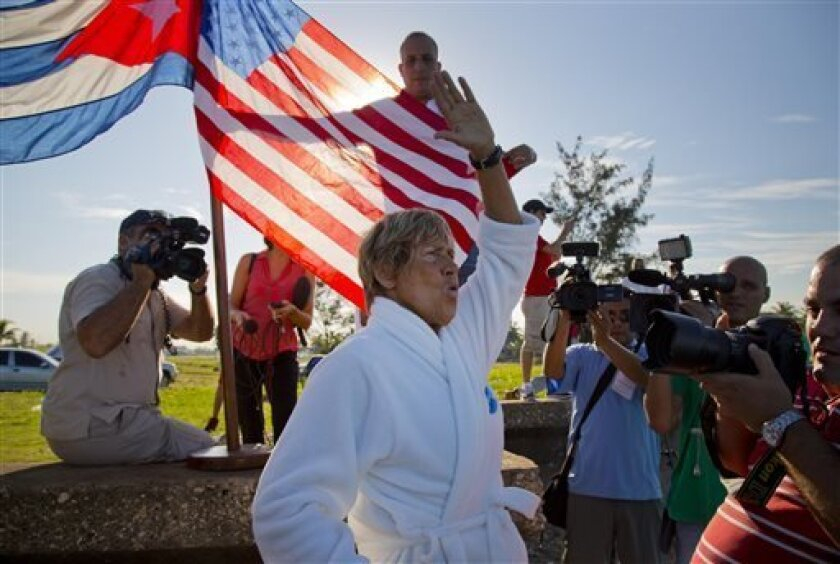 U.S. swimmer Diana Nyad, 64, salutes before her swim from Havana, Cuba, to Florida in Havana on Saturday, Aug. 31, 2013. Endurance athlete Nyad launched another bid Saturday to set an open-water record by swimming from Havana to the Florida Keys without a protective shark cage. (AP Photo/Ramon Espi