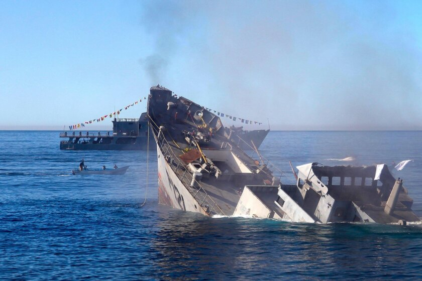 The former patrol vessel Uribe 121 sinks to its final resting place off the coast of Rosarito Beach Saturday.