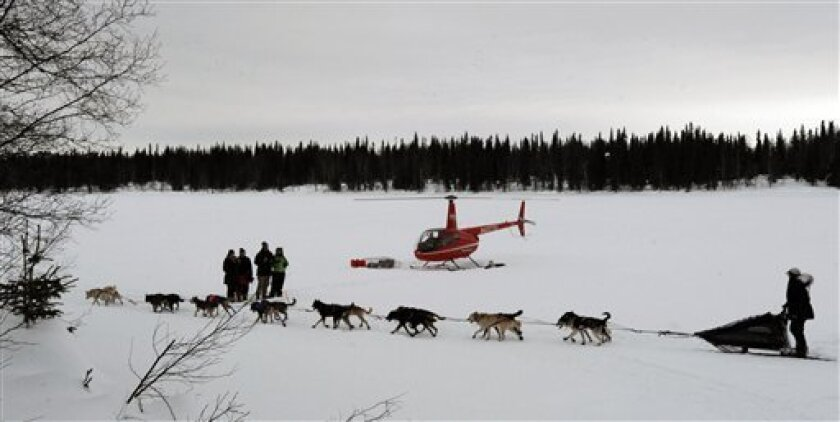 Jessie Royer leaves the Finger Lake checkpoint in Alaska during the Iditarod Trail Sled Dog Race on Monday, March 4, 2013. (AP Photo/The Anchorage Daily News, Bill Roth)