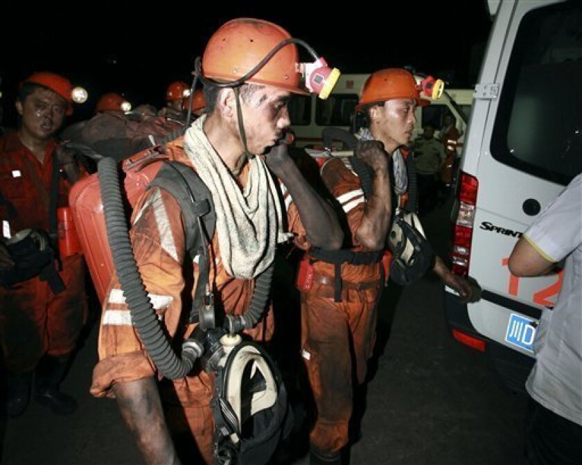 In this photo released by China's Xinhua News Agency, rescuers work at Xiaojiawan Coal Mine in Panzhihua City, southwest China's Sichuan Province, Thursday, Aug. 30, 2012. A gas explosion at the mine killed over a dozen miners and trapped dozens more, state media reported Thursday. (AP Photo/Xinhua