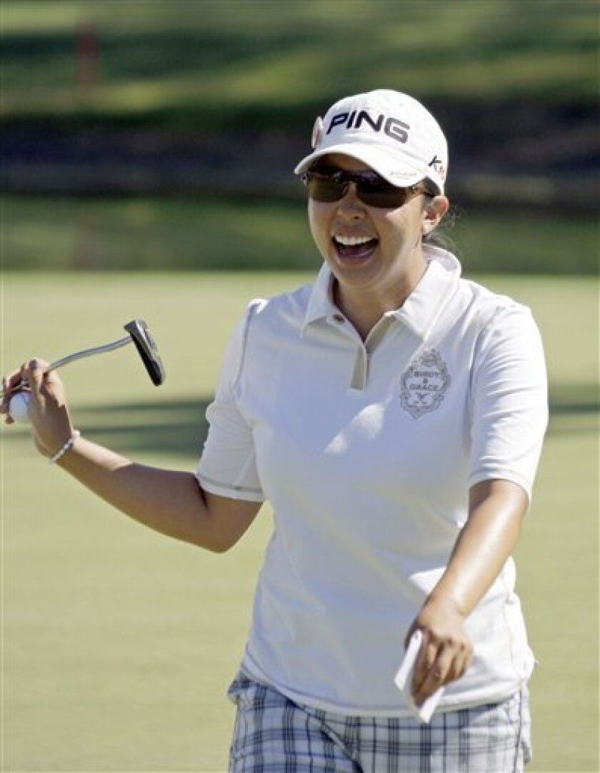 Jane Park celebrates a birdie on the fifth green in the first round of the LPGA Kraft Nabisco championship golf tournament at Mission Hills Country Club in Rancho Mirage, Calif., Thursday, March 31, 2011. (AP Photo/Reed Saxon)