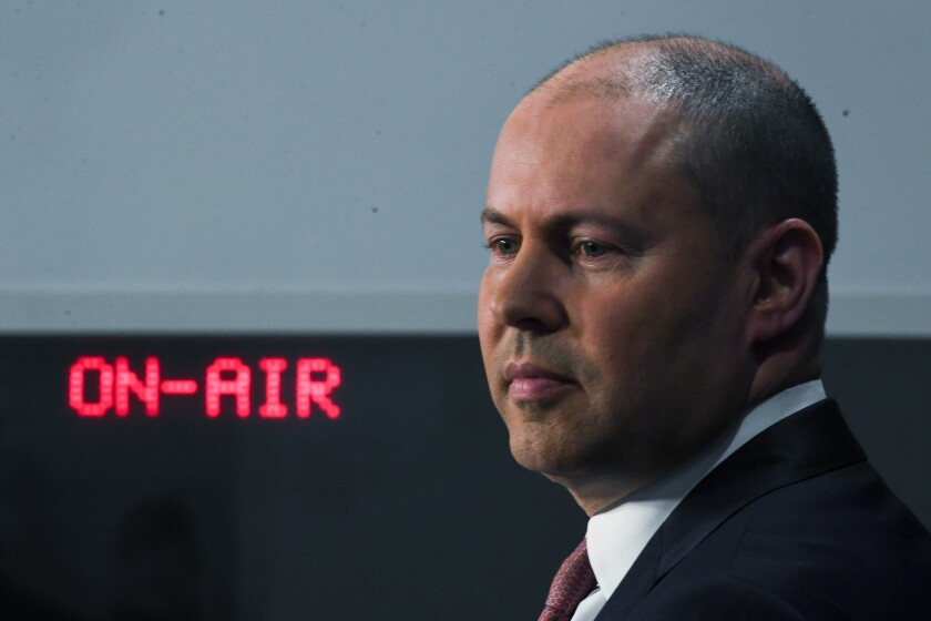 Australian Treasurer Josh Frydenberg speaks to the media during a press conference at Parliament House in Canberra, Tuesday, Dec. 8, 2020. Australia's government will reveal legislation in Parliament on Wednesday that would make Facebook and Google pay for journalism. (Lukas Coch/AAP Image via AP)