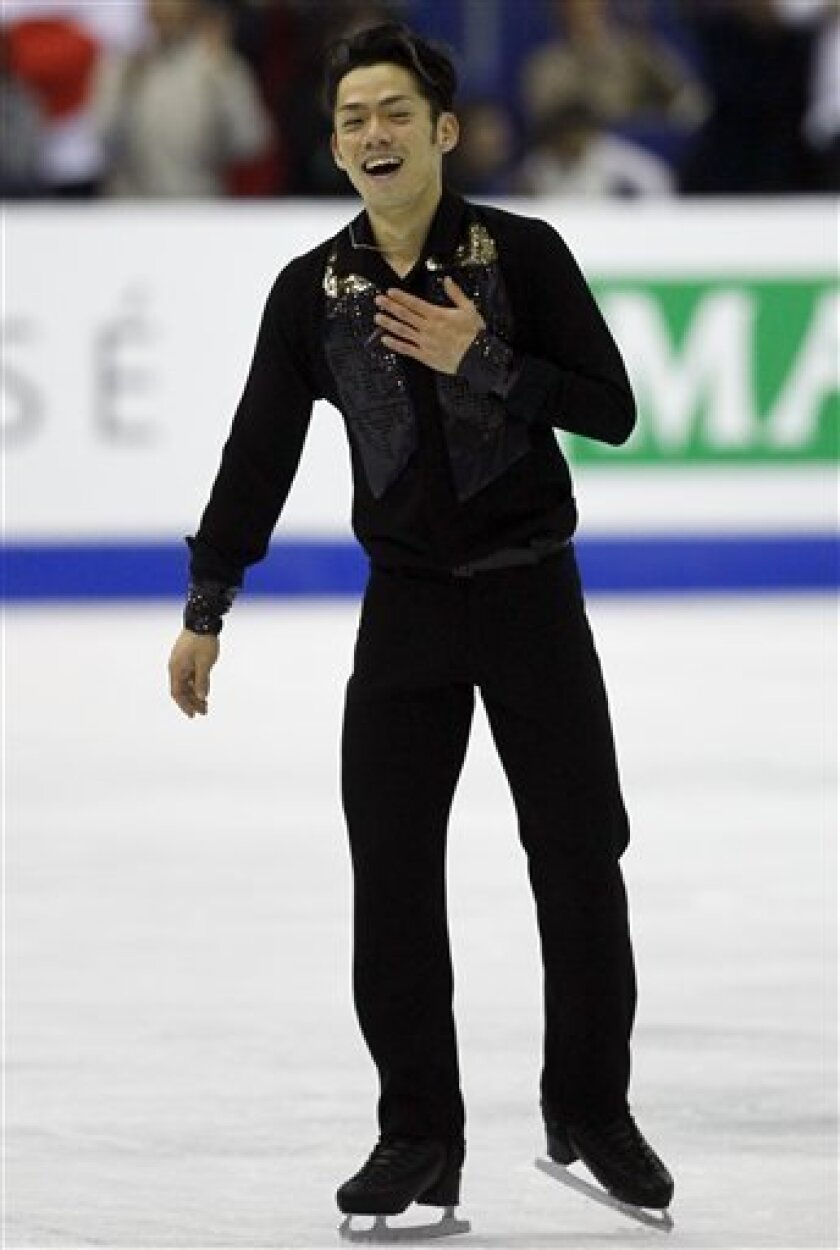 Daisuke Takahashi of Japan reacts after performing his Men's Free skating at the ISU 2012 World Figure Skating Championships in Nice, southern France, Saturday, March 31, 2012. (AP Photo/ Francois Mori)