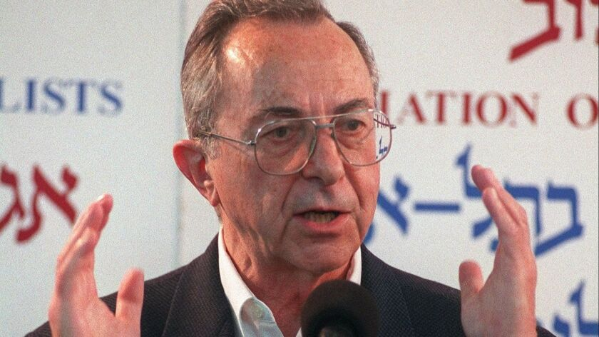 Moshe Arens speaks at a press conference in 1999 when he announced his candidacy for prime minister.