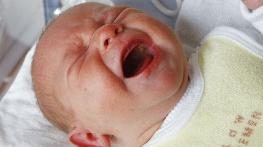 FILE - In this Wednesday, Nov. 12, 2008 file photo, a baby cries in its bed in a hospital in Bremen,
