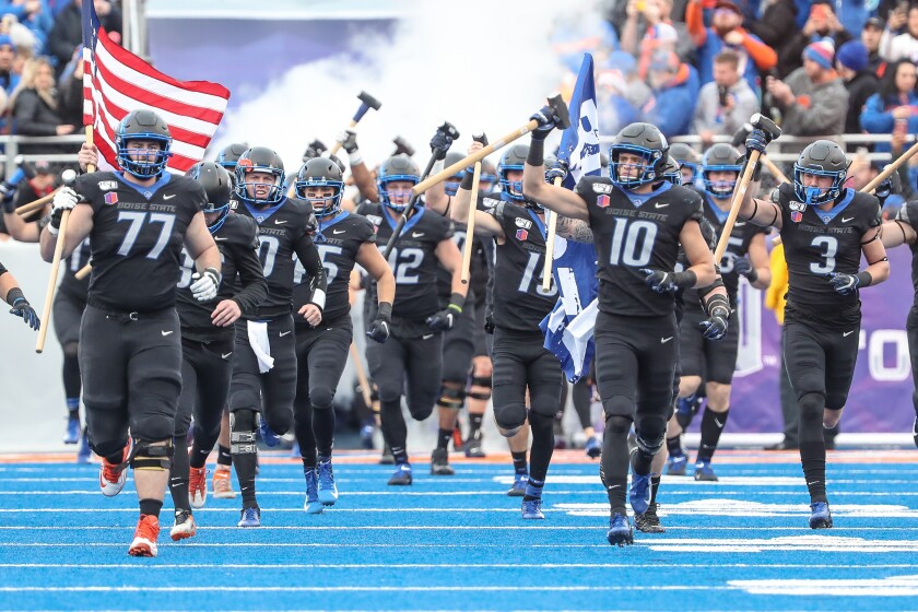 Boise State players enter the field prior to the start of first half action in the Mountain West championship against Hawaii on Dec. 7 in Boise, Idaho. Boise State won the game 31-10.