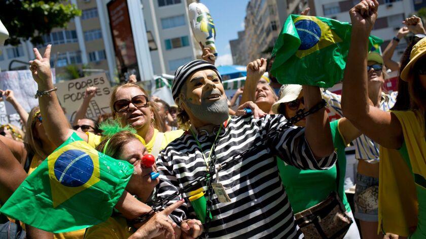 A demonstrator in the likeness of former Brazilian President Luiz Inacio Lula da Silva, in prison stripes, joins marchers in Rio de Janeiro last month to protest government corruption.