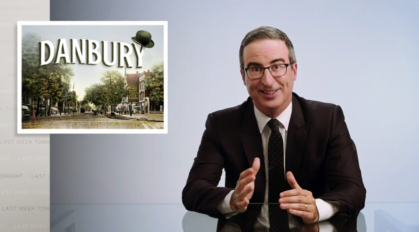 """This video frame grab shows John Oliver from his """"Last Week Tonight with John Oliver"""" program on HBO, Sunday, Aug. 30, 2020. On Saturday, Aug. 22, 2020, Danbury, Conn., Mayor Mark Boughton announced a tongue-in-cheek move posted on his Facebook page to rename Danbury's local sewage treatment plant after Oliver following the comedian's expletive-filled rant about the city. Oliver has upped the stakes, on his program, Sunday, offering to donate $55,000 to charity if the city actually follows through on a joke to name its sewage treatment plant after him. (HBO via AP)"""