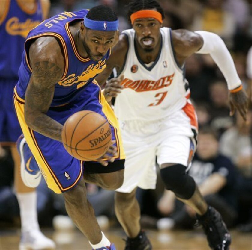 Cleveland Cavaliers' LeBron James, left, beats Charlotte Bobcats' Gerald Wallace (3) to a loose ball during the second quarter of an NBA basketball game Wednesday, Jan. 7, 2009, in Cleveland. (AP Photo/Mark Duncan)