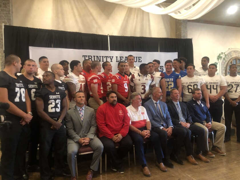 Players and coaches gather Friday for the first Trinity League football media day.