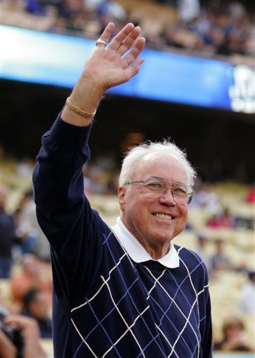 FILE - In this May 10, 2006, file photo, Former Brooklyn and Los Angeles Dodgers center fielder Duke Snider waves to fans prior to the Dodgers' baseball game against the Houston Astros in Los Angeles. Snider, 84, died early Sunday, Feb. 27, 2011, of what the family called natural causes at the Vall