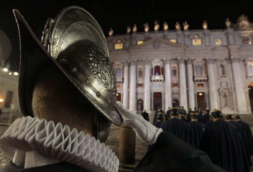 A Swiss guard salutes in St. Peter's Square at the Vatican, Wednesday, March 13, 2013. Argentine Jorge Bergoglio was elected pope Wednesday and chose the papal name Francis, becoming first pontiff from the Americas and the first from outside Europe in more than a millennium. (AP Photo/Gregorio Borg
