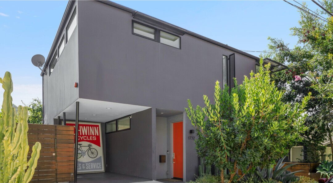 Built in 2016, the colorful home boasts Midcentury vibes with clean lines, clerestory windows and lots of built-ins.