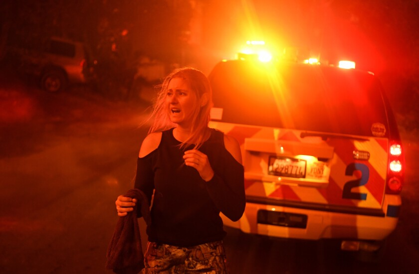 La Conchita resident Laura Hinz, can't find her ride as the Thomas Fire approaches the town of La Conchita early Thursday morning.