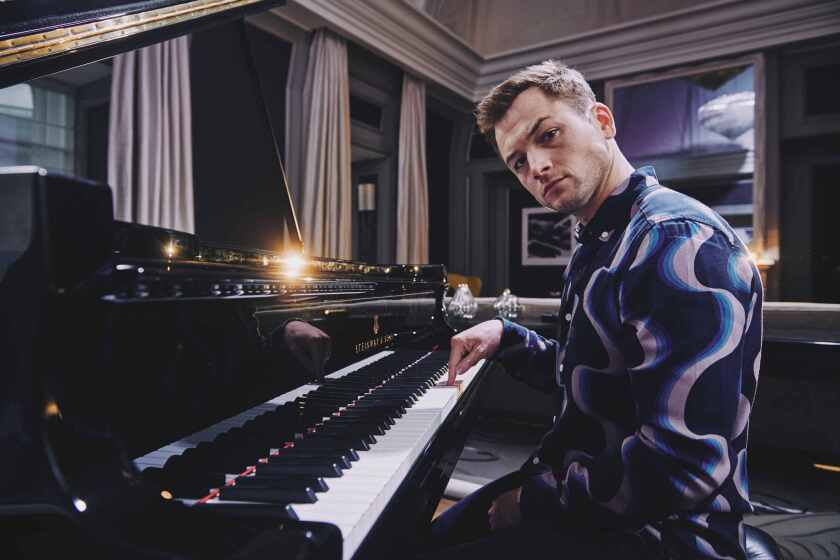 """British actor and singer Taron Egerton, who plays Elton John in the biopic """"Rocketman,"""" photographed at the Corinthia hotel in London."""