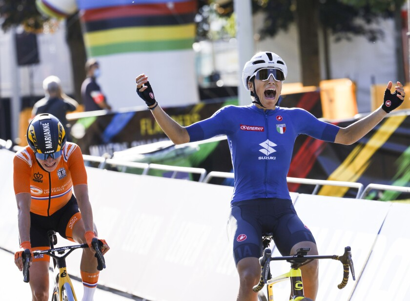 Elisa Balsamo of Italy crosses the finish line ahead of Marianne Vos of The Netherlands, left, to win the women's road race of the World Road Cycling Championships in Leuven, Belgium, Saturday, Sept. 25, 2021. (AP Photo/Olivier Matthys)