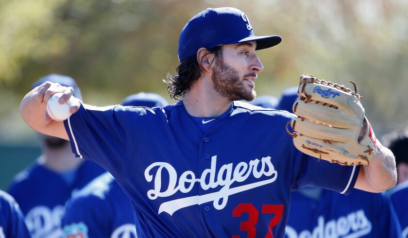 Dodgers starting pitcher Brandon Beachy participates in a spring training workout at Camelback Ranch on Feb. 20 in Glendale, Ariz.