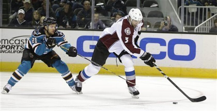 Colorado Avalanche's Ryan O'Byrne, right, moves the puck past San Jose Sharks' T.J. Galiardi (21) during the second period of an NHL hockey game Tuesday, Feb. 26, 2013, in San Jose, Calif. (AP Photo/Ben Margot)