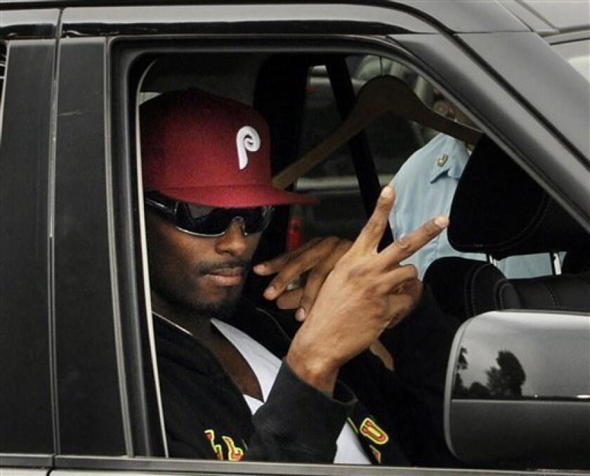 Former New York Giants star Plaxico Burress gestures from a car after being released from the Oneida County Correction Facility in Rome, N.Y., Monday, June 6, 2011. Burress was released from prison after spending nearly two years behind bars on a gun charge. (AP Photo/Heather Ainsworth)