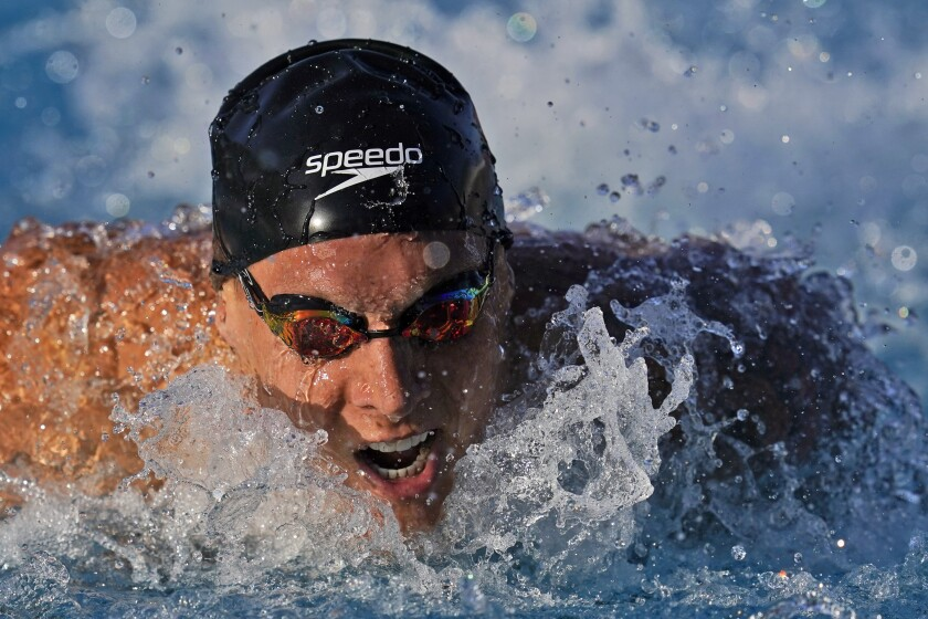 FILE - In this April 8, 2021, file photo Caeleb Dressel competes in the men's 100 meter butterfly prelim at the TYR Pro Swim Series swim meet in Mission Viejo, Calif. (AP Photo/Ashley Landis, File)