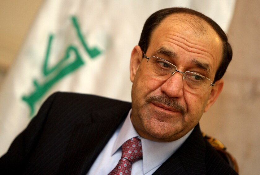 Former Iraqi Prime Minister Nouri Maliki listens to a question during an interview in Baghdad on Feb. 5, 2011.
