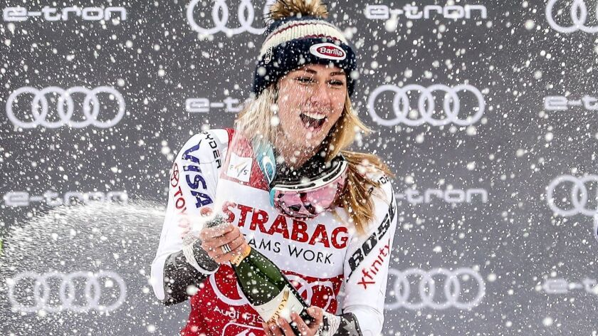 Mikaela Shiffrin celebrates her slalom victory on Saturday amidst the snow and spraying of bubbly.