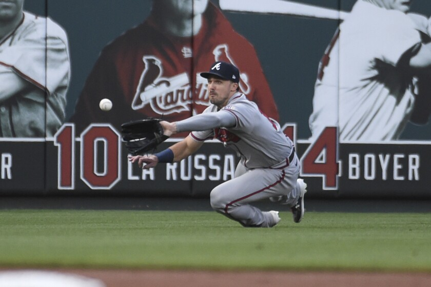 Atlanta Braves left fielder Adam Duvall catches a fly ball hit by St. Louis Cardinals' Yadier Molina during the first inning of a baseball game Wednesday, Aug. 4, 2021, in St. Louis. (AP Photo/Joe Puetz)