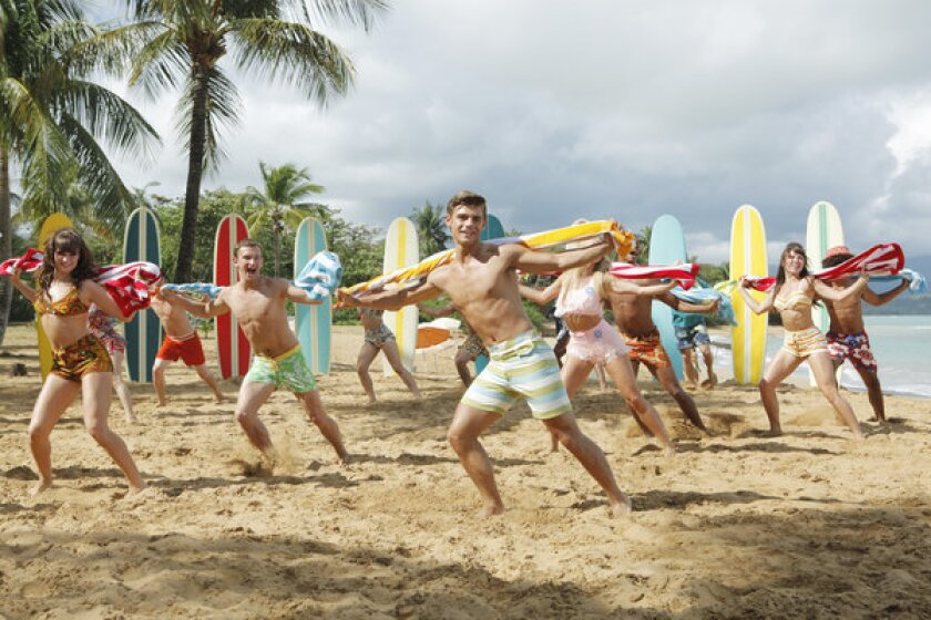 """Garrett Clayton, center, and the cast of """"Teen Beach Movie,"""" which premieres at 8 tonight on the Disney Channel."""
