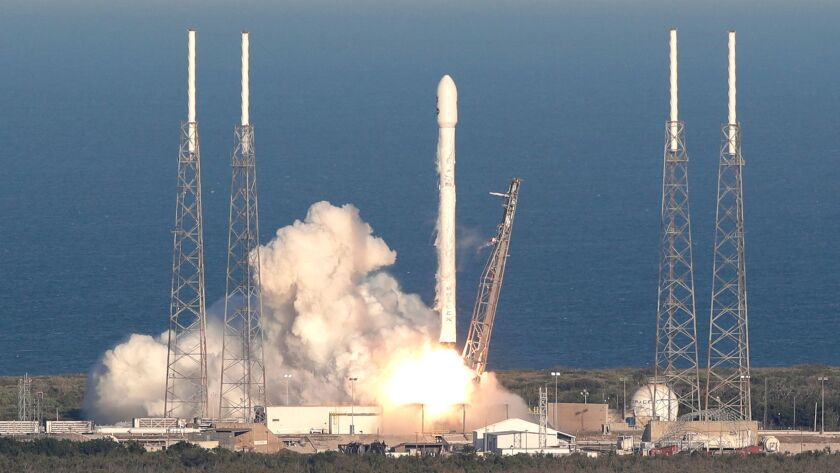 A SpaceX Falcon 9 rocket transporting the Tess satellite lifts off from launch complex 40 at the Cap