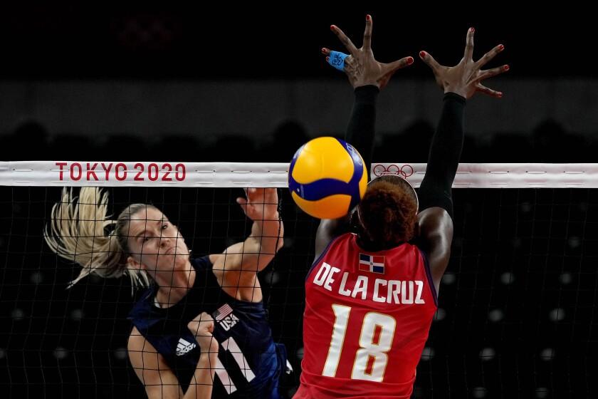 Andrea Drews spikes the volleyball past the Dominican Republic's Bethania de la Cruz de Pena at the Tokyo Olympics.