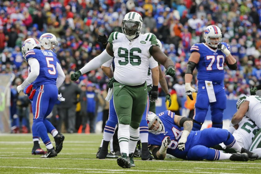 FILE - In this Jan. 3, 2016, file photo, New York Jets' Muhammad Wilkerson (96) celebrates after Buffalo Bills' Tyrod Taylor (5) fumbled the ball during the first half of an NFL football game in Orchard Park, N.Y. Fresh off signing a new multiyear contract, Wilkerson expressed his confidence on Wed