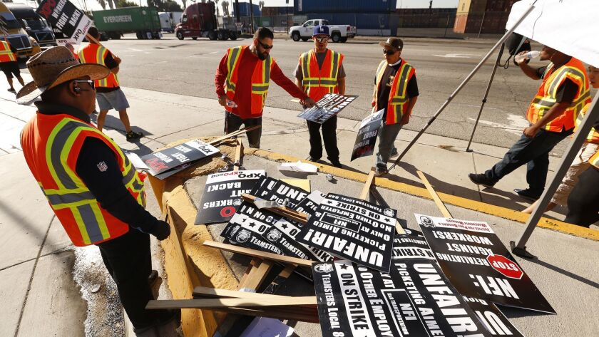 WILMINGTON, CA - OCTOBER 1, 2018, Picketers select their signs before walking the picket line at the