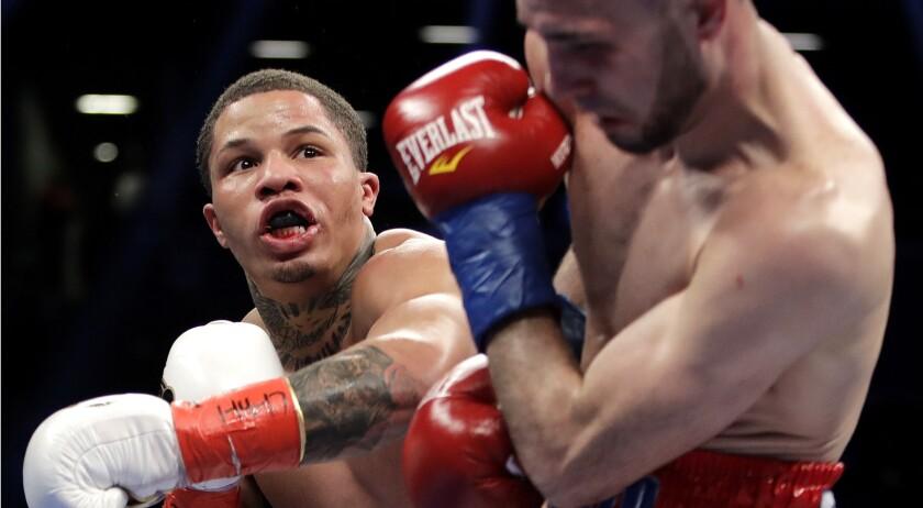 Gervonta Davis lands a punch against Jose Pedraza during a fight in 2017.