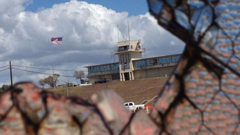 The war court headquarters at Camp Justice as seen through a broken window at an air hangar at the U.S. Navy base in Guantanamo Bay, Cuba on Feb. 28, 2015.