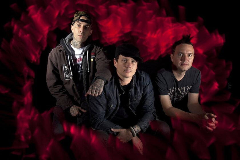 Travis Barker, left, Tom DeLonge and Mark Hoppus are the original members of Blink-182. Despite what his bandmates say, DeLonge insists he is still a member of the band.