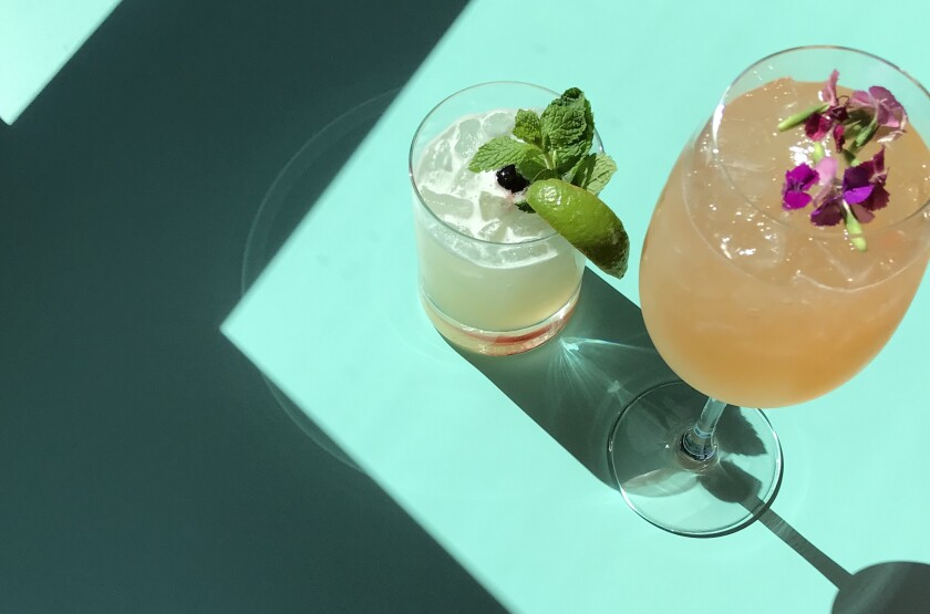 """Described by founder Frank Vizcarra as """"fine casual,"""" Lola 55 has an appealing cocktail program. Pictured are the Holy Pinata and Tequila Sling."""