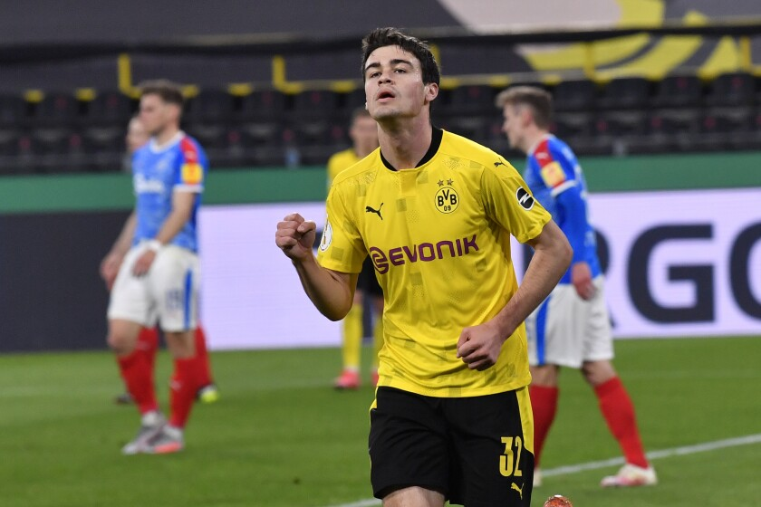 Dortmund's Giovanni Reyna celebrates after scoring his side's second goal during the German Soccer Cup semifinal match between Borussia Dortmund and Holstein Kiel in Dortmund, Germany, Saturday, May 1, 2021. (AP Photo/Martin Meissner, Pool)