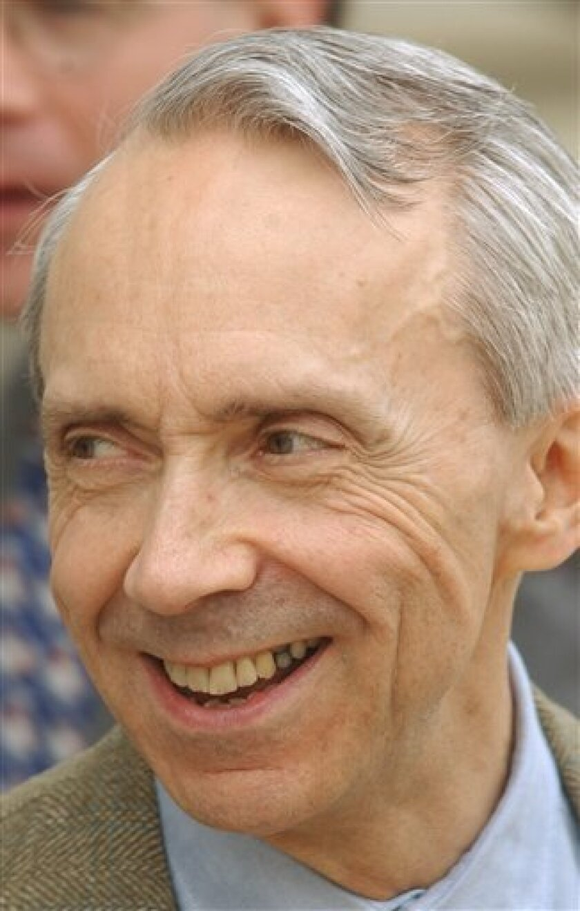 FILE - In this April 7, 2005 file photo, U.S. Supreme Court Justice David Souter talks with friends in Concord, N.H., while he visited his native New Hampshire on break from the court. (AP Photo/Jim Cole, File)