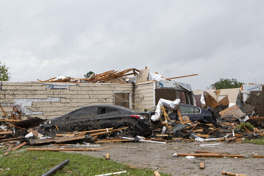A tornado ripping through Monroe, La., tore off this home's roof just before noon Sunday while also causing extensive damage in the neighborhood and at the regional airport.
