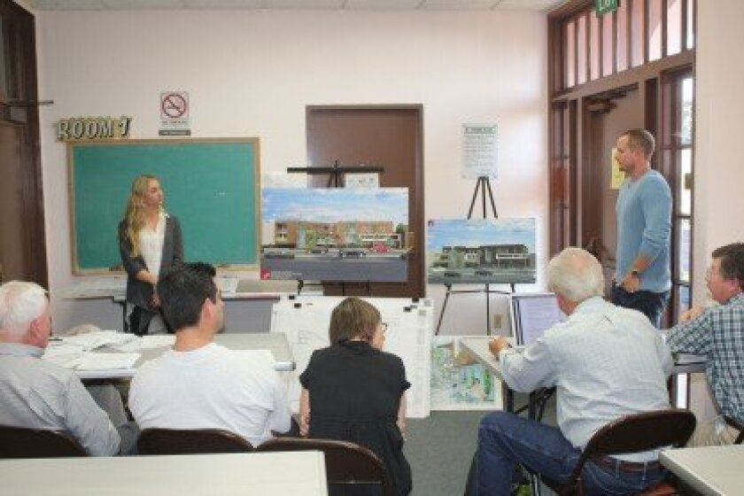 Ashley Prikosovits and Philip Quatrino (both standing) of PQ Design Studio introduce revised plans for a mixed-use project next to the Vons market on Girard Avenue. The DPR subcommittee rejected the project.